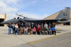 RAFB workers pose with the F-15E they repaired following damage from a birdstrike. (U.S. Air Force photo by Sue Sapp)