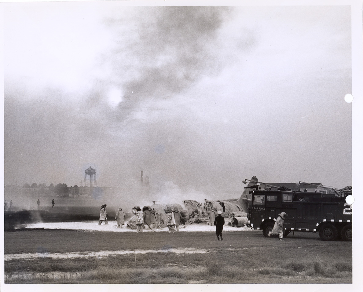 Firefighters extinguish the JetStar that crashed while landing at Robins AFB in 1962.