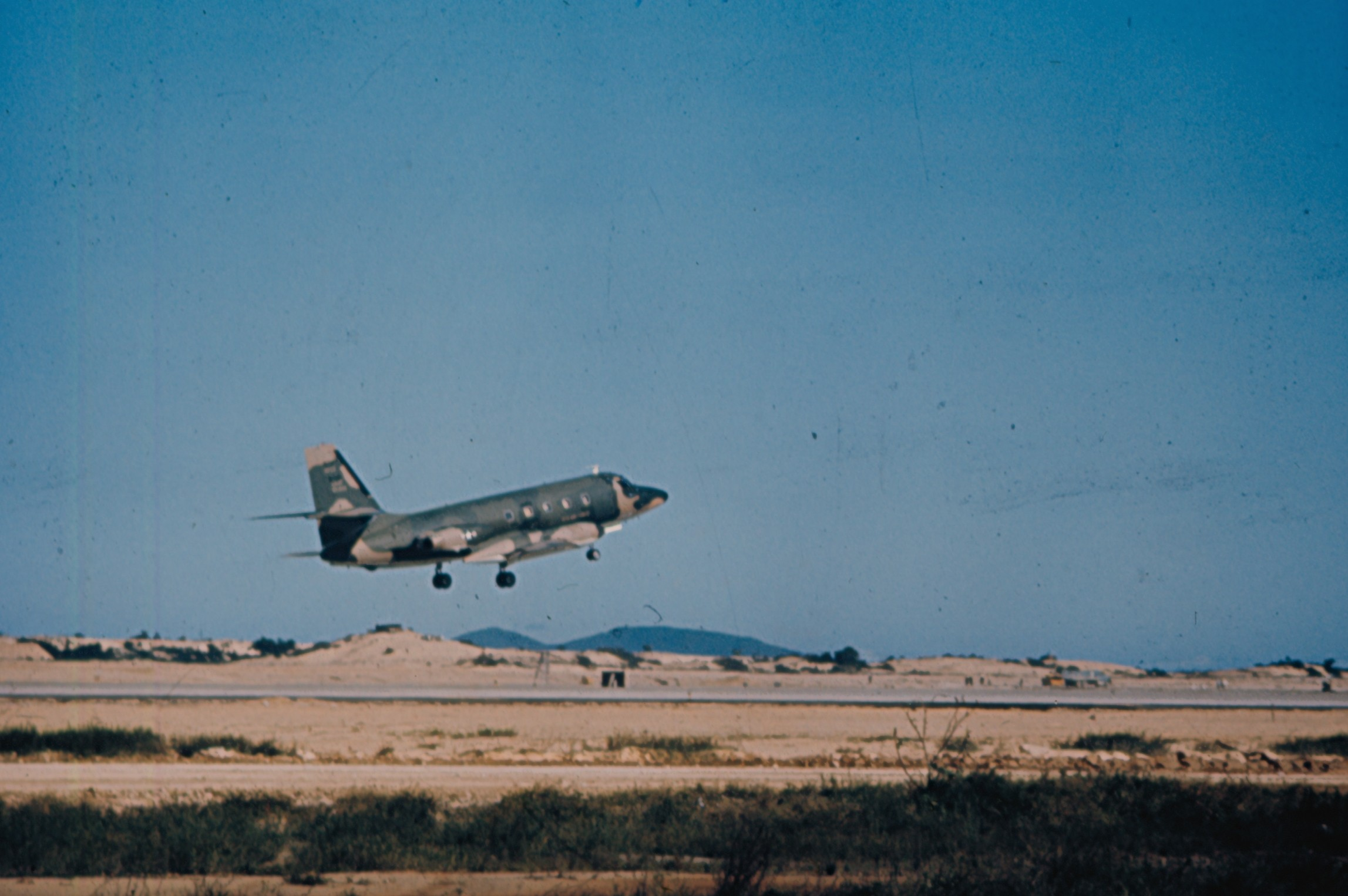 JetStars wore a camouflage paint scheme for operations in Southeast Asia during the  Vietnam War. This C-140A is taking off from Tan Son Nhut Air Base in South Vietnam.