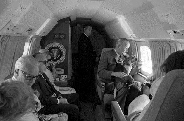 President Johnson (at right, looking out the window) aboard the museum's JetStar  on June 3, 1966 enroute to his ranch. (LBJ Library/photo by Yoichi Okamoto.)