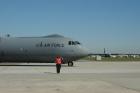 Steve Neal, C-141 run technician, salutes as 65-0248 taxis toward the runway. (US Air Force photo by Eric Palmer)