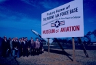 Leaders from Robins Air Force Base and the local community gather by a sign marking the future home of the Museum of Aviation.